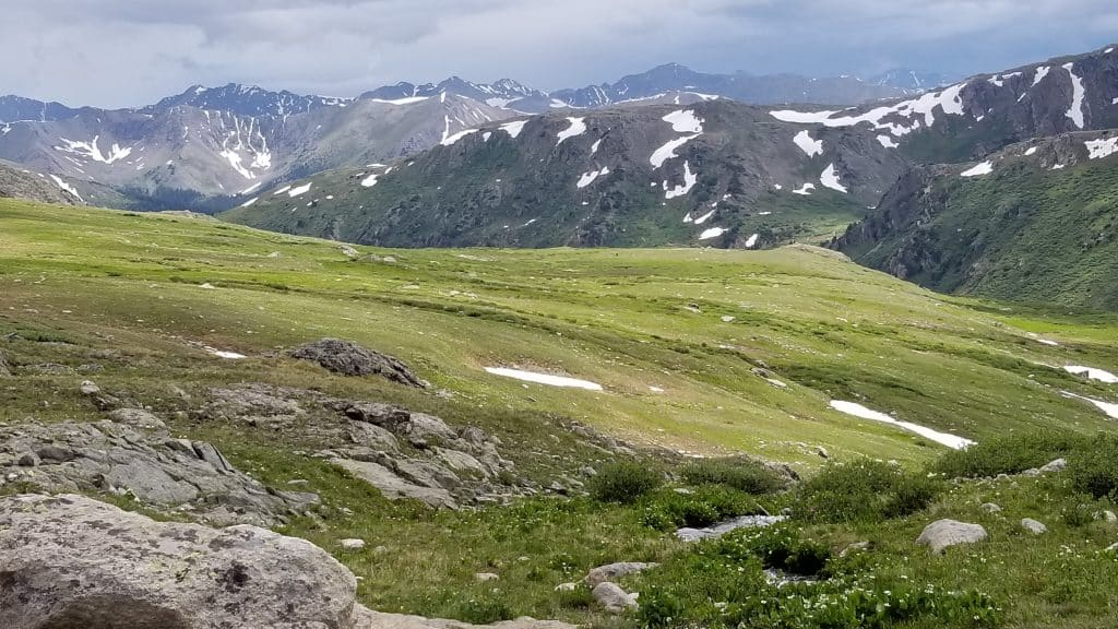 Panorama of Rockies with walking poles